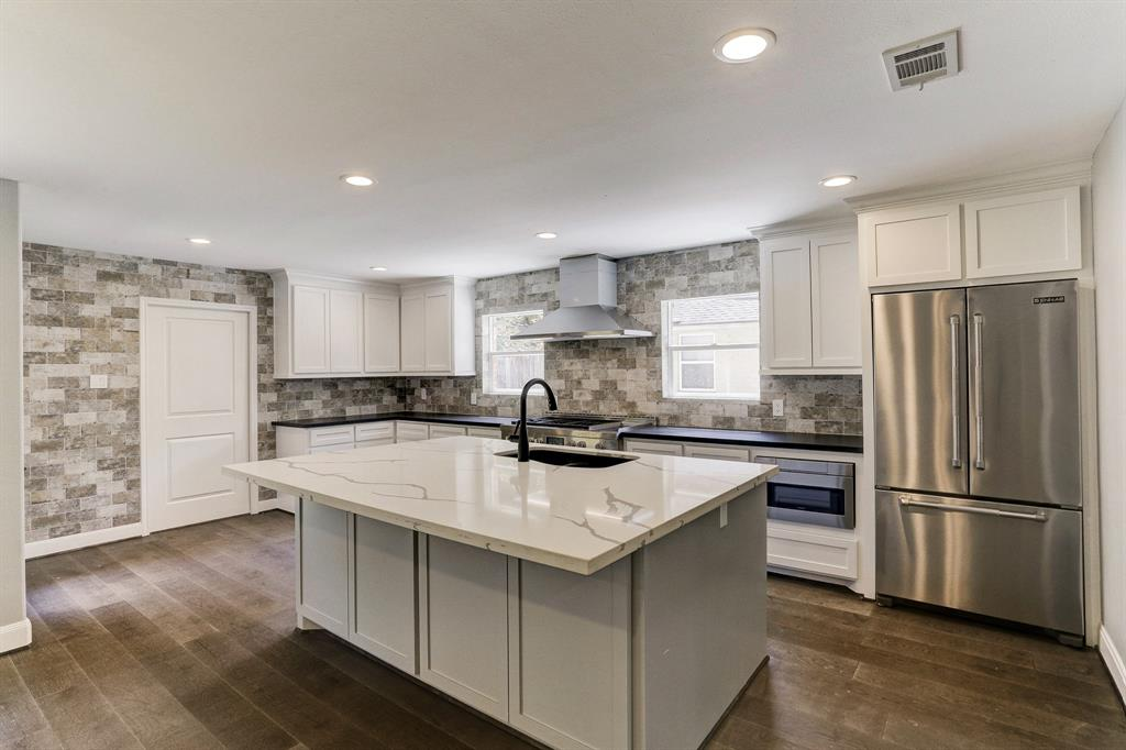 The inside of this home has been extensively remodeled.   It features a downstairs master, large open floorplan, pro style kitchen, 3 full and 2 half bathrooms.  Garage is new construction as well as a 500 sq ft 2nd story addition. All plumbing on house has been replaced (PEX and underground). New roof was added in 2017 upon completion of second story framing.  Home boasts 2 large hot water heaters as well.