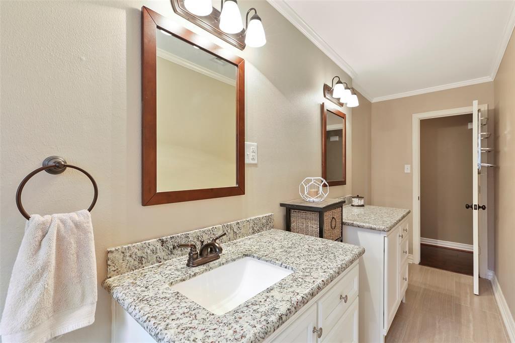 Updated hall bathroom with new vanities, tile and fixtures.