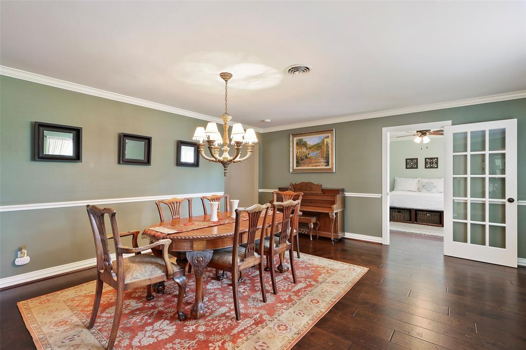 The large dining room features updated wood floors and crown molding.