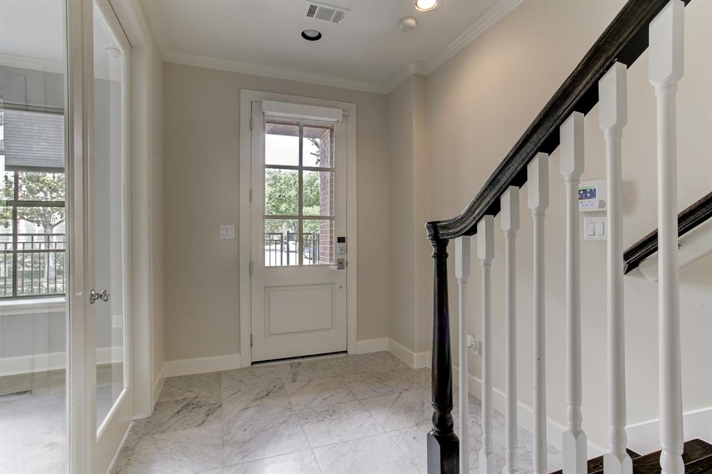 The entry here is conveniently key-less and the home is outfitted with a security system (buyer responsible for service).