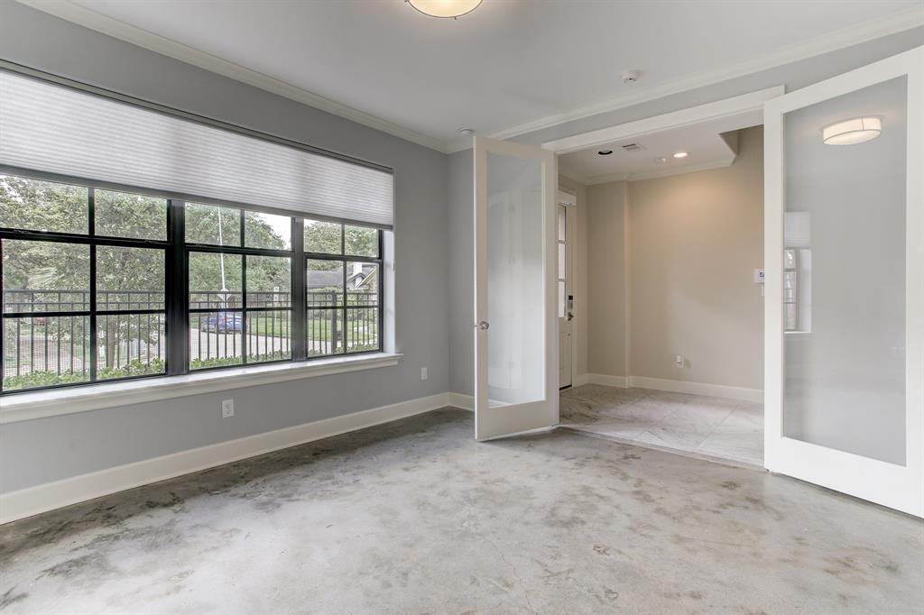 Looking towards the entry hall and front door from the first floor bedroom/office.