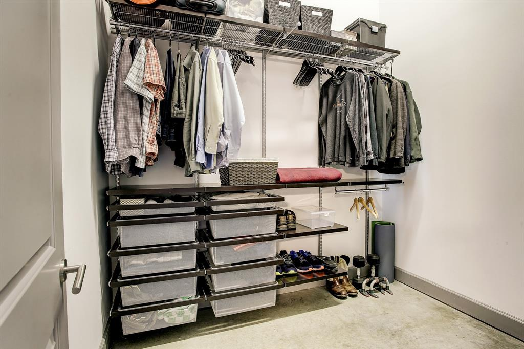The master closet is outfitted with flexible Elfa components...