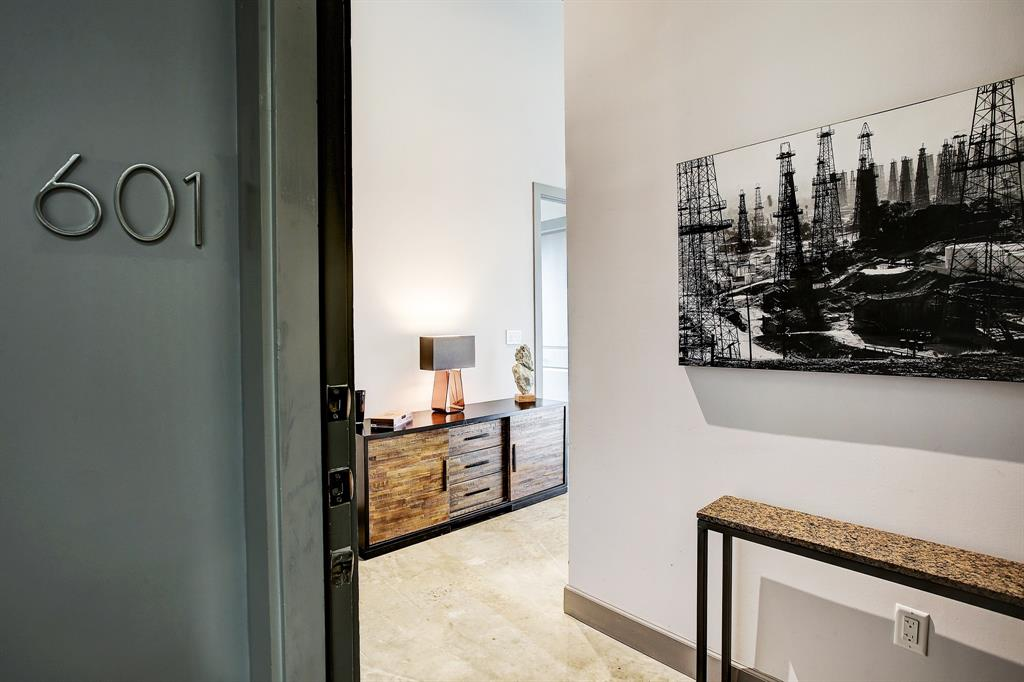 Welcome to 1111 Studewood, #601, a corner, penthouse level, loft style condo in the heart of The Heights!