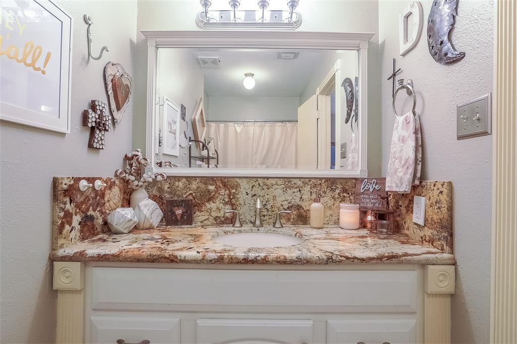 Updated hall bathroom with granite counter top.