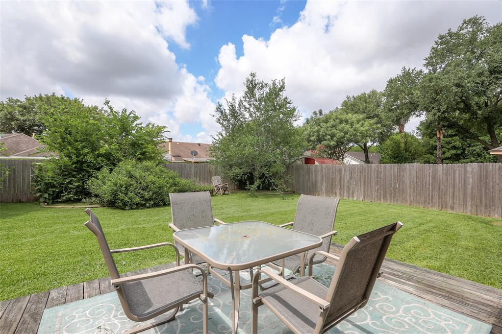 Large, fenced back yard is perfect for family fun and BBQs.