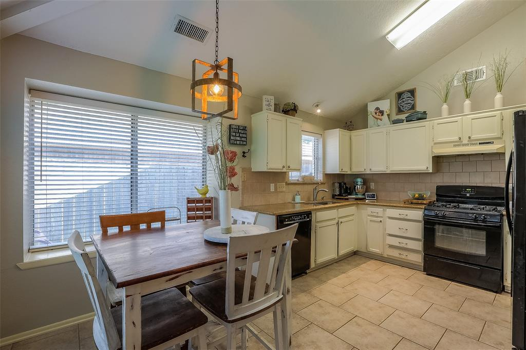 The updated kitchen is open to the dining space and living room.