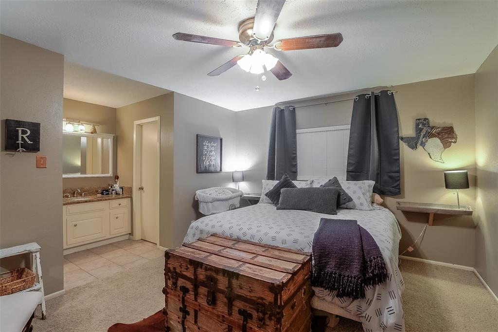 The master suite features an updated bathroom and good closet space.
