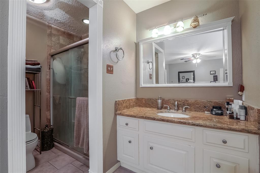 The master bath features a granite counter top and tile floor and shower surround.
