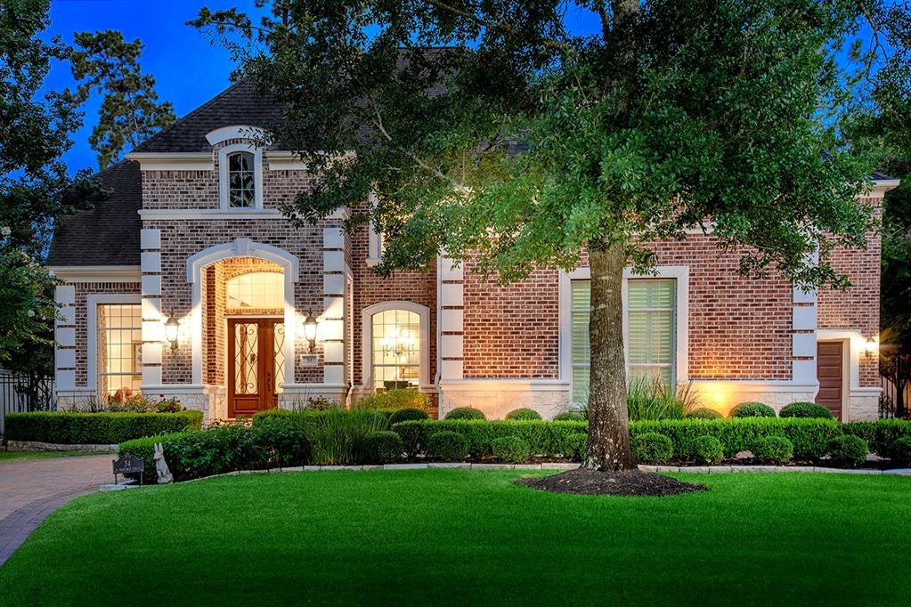 Remodeled custom home in the Provence neighborhood of guard gated Carlton Woods Nicklaus! Paver circular drive, new carpet and hardwood floors, Tankless water heater 2019, downstairs A/C 2018, upstairs A/C 2016, new wood-look tile in master bath, guest and upstairs baths, dual wrought iron staircases, art niches, Plantation shutters, wine grotto, detailed trim work & much more! Open, light and airy island kitchen with breakfast bar, new quartzite counters and backsplash, and walk-in pantry overlooks breakfast room and den; elegant formal dining; handsome study with French doors and built-ins; master retreat and 2nd bedroom down; three bedrooms, game room and study nook up; 3 car attached garage; covered patio, remodeled PebbleTec pool and spa all surrounded by mature shade trees and pristine landscaping.