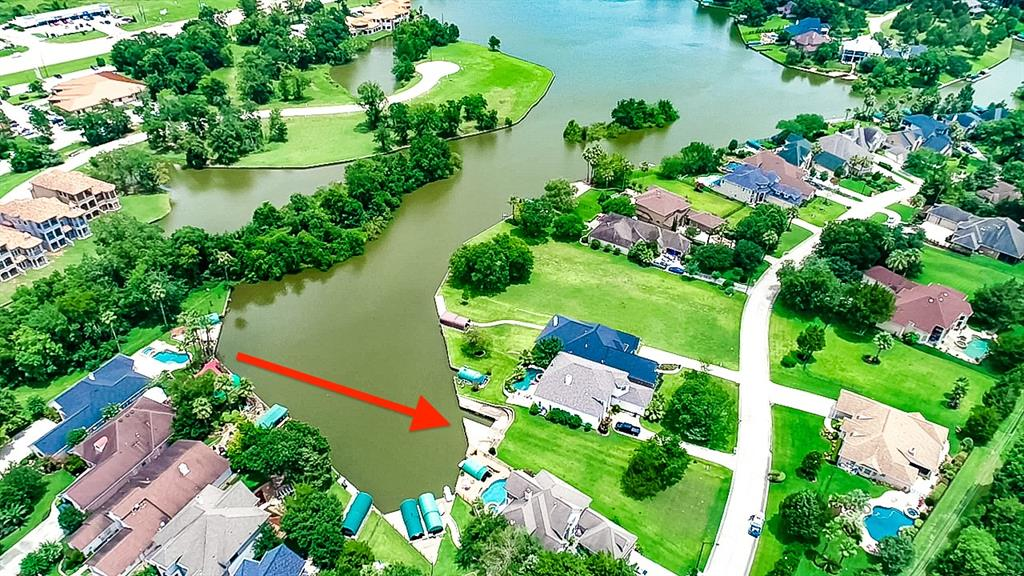 WATERFRONT lot on LAKE CONROE that already has your BOAT DOCK, SLIP, AND LIFT! Bring your boat RIGHT NOW and start enjoying your waterfront property. This lot is located in a beautiful Blue Heron Bay! It's a great LOCATION! You are in a small community that is well kept and has beautiful homes. Your lot is in a cove to protect against rough waters and the damage they can do, but you are also not on a canal so you have more of an open water view. It's peaceful so you can enjoy kayaking, canoeing, etc. You are very close to HWY 105 and I-45, Montgomery, Conroe, The Woodlands, Magnolia and every amenity you could ask for as well. This lot is ready to build! Low dues, and a great opportunity to own Lake Conroe waterfront property! Come get it!
