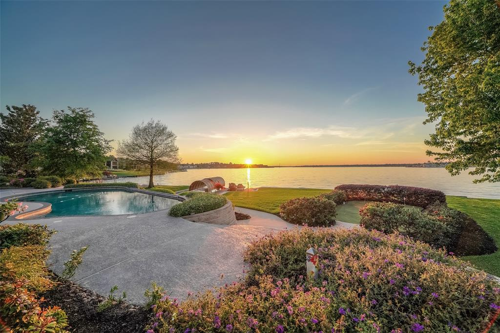Stunning home in the gated Walden Estates! This home has unparalleled views of Lake Conroe and the attention to detail in this home is unmatched! The large foyer is open and welcomes you with beautiful arched doorways and travertine floors. Custom baseboards, crown molding, archways and built-ins are thoughtfully and beautifully included throughout the home. Large windows in the home bring in lots of natural light and allow for panoramic views of the lake. With 5 bedrooms, 6 baths, game room, and office, there is room for everyone! Two rooms off of the garage are specifically built as pet rooms, but could be a craft, play or exercise room! As a pet room, your pets will have access to the screened porch through the special door built just for them! Security and music systems throughout the home and boat dock. 24,000 gallon heated salt water pool. Generator provides power for first floor in outage. Large walk-in attic. Tennis, yacht club, boat ramps and Montgomery schools.