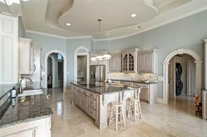 The spacious kitchen is perfect for entertaining or hosting large gatherings.
