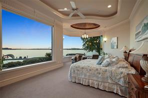 The extensive trim work and unique ceiling details create a special master retreat with space for an additional seating area. The view of Lake Conroe from the master is simply breathtaking!