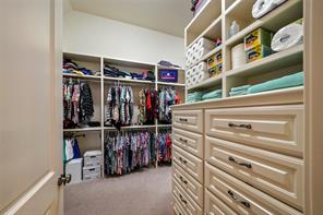 The master closet is a dream with built-in storage and an owner's safe.