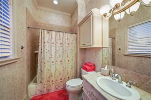 This en suite bath is similar with extensive custom trim, millwork  and neutral finishes.