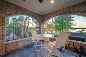 The side screened porch has beautiful arched openings for year-round, bug-free outdoor space! There are two rooms with pet doors to allow your pets to the outdoor air without fear of them leaving the home.