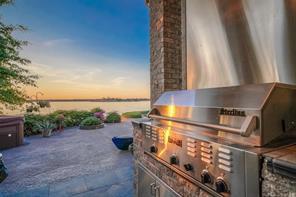 Built-in gas grill is perfect for outdoor gatherings! Who wouldn't love to cook outside with that view?
