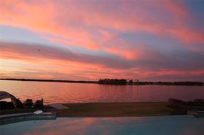 "Sellers personal photo. ""Enjoying the sunsets at this home has been a cherished memory!"""