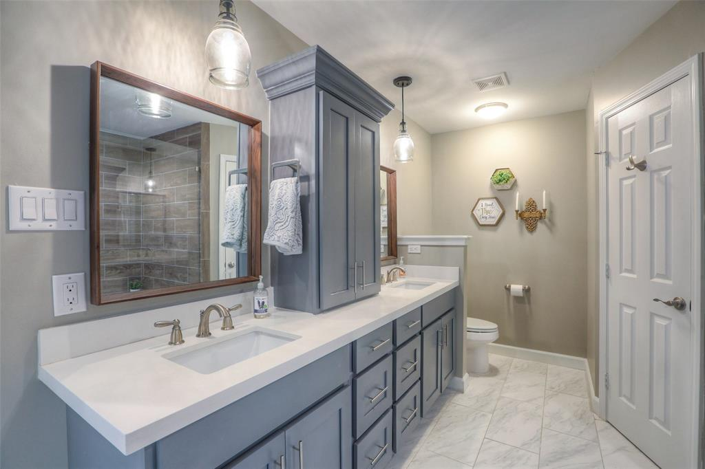 Master bathroom has two walk-in closets.