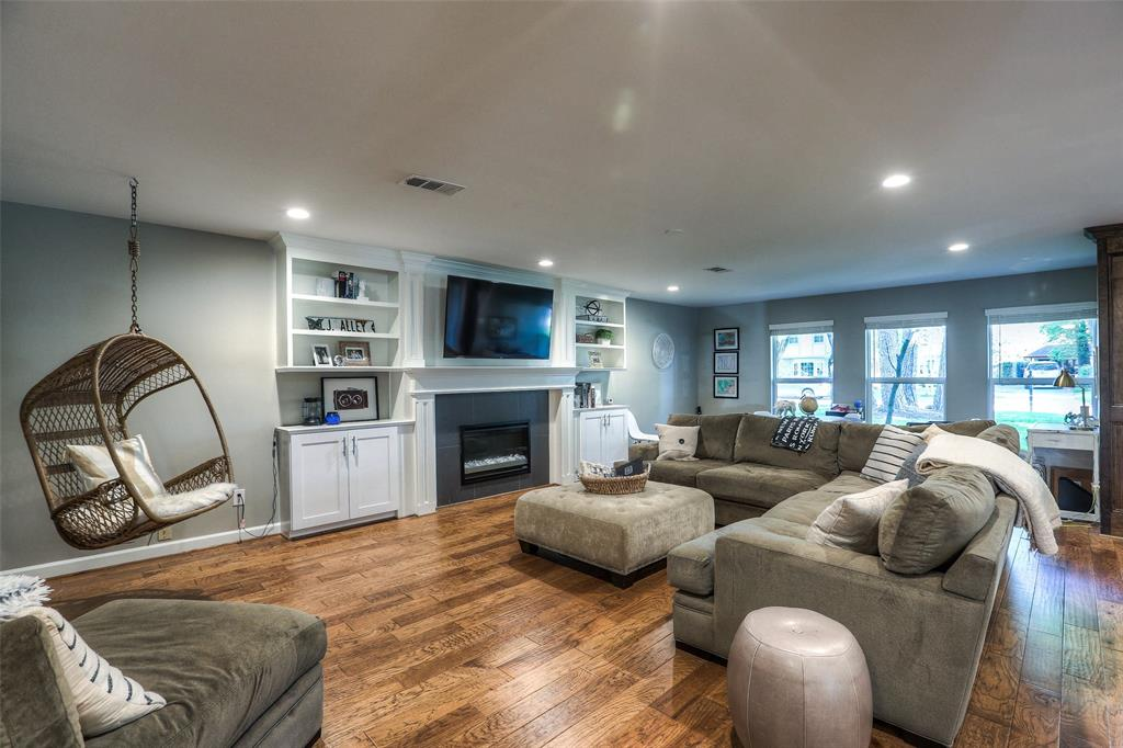 Large open floor plan with hand-scraped hardwood flooring throughout.