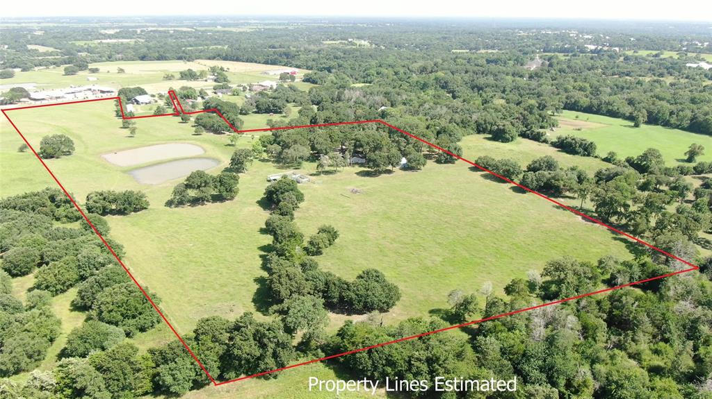 Unique opportunity in Round Top! 21+ Acres with substantial road frontage on the Higher-End of HWY 237/Antique Corridor, with hot-spot venues surrounding. There are also 2 homes on the property, nestled in the live oaks and overlooking the ponds. Main house is 2700+ sq ft with 4 bedrooms/3 ½ baths, large kitchen and is great for entertaining. Guest House has 2 bedrooms/2 baths. Pretty views and open spaces lends this property to lodging in the back and a great venue in the front.