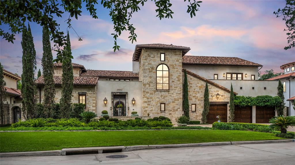 Designed by Robert Dame, this Palladian-style villa features Austin limestone; stucco; copper gutters, chimney caps, and gas lanterns; custom-blend clay tile roof; front-door camera security system; & oversized 3-car garage. Interiors w/ reclaimed 18th-19th c. architectural elements; Jay Iarussi finishes; reclaimed hardwood & French limestone floors. Gas-log fireplaces w/ antique mantles. Dining room w/ limestone floor & walls, vaulted ceiling, & French doors overlooking repurposed stone trough/fountain. Main kitchen w/ Viking appliances; Shaw sink; granite countertops; & Iarussi cabinet finishes. Full catering kitchen. Wine vault w/ antique doors. Master w/ vaulted & beamed ceiling; fireplace; surround-sound system; & marble-clad bath. Outdoor living w/ gas log fireplace; full summer kitchen; & half-bath. 1-bedroom casita w/ kitchenette & full bath. Library/Study; media room; art studio; dark-bottomed pool & spa; professional landscaping, tree & path lighting. Elevator.