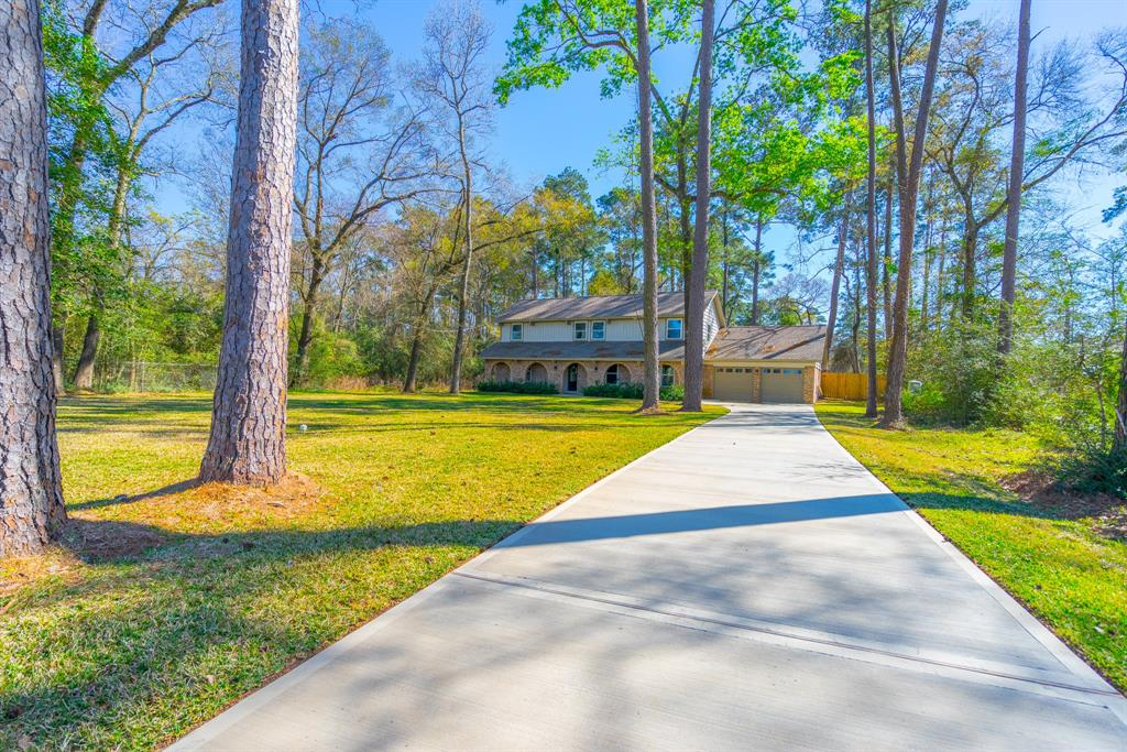 Come and see this beautifully remodeled Home that sits on just over a half acre and just minutes away from all of the popular destinations in The Woodlands! This property has a brand new well and septic system, Wood floors, Open Kitchen Space, new appliances, two driveways, new HVAC and water heater, New Roof, and the list goes on! Come see this dream home today!