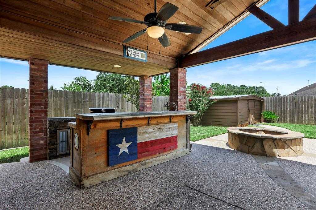 "Easy Summer Living with your own BACKYARD RETREAT!Cool off in the pool, relax in the hot tub, enjoy the covered patio & out door kitchen! Cuddle up by the fire pit on those cooler evenings. This generously spacious home has study, formal dining, oversized family room with corner fireplace open to the kitchen. The functional kitchen has granite w/ tile back splash, 42"" cabinets plus pull out drawers & recent farm sink & breakfast bar with large breakfast area.The magnificent owners retreat overlooks the backyard pool & master bath has dual sinks, large jetted tub, sep. shower & walk in closet.The huge game room will be perfect for pool table fun or an oversized media area w/large storage closet. There are also 4 bedrooms and 2 baths upstairs. You will love this gated neighborhood with lake & walking trails. Nearby schools and newly renovated Independence park with dog park. Enjoy firework festivities on July 4th without leaving the neighborhood! EZ access to the Parkway, Beltway & 45."