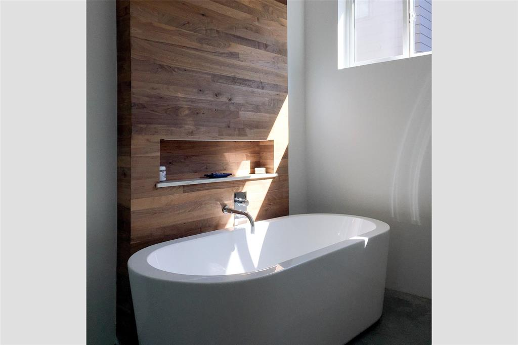 Over-sized tub provides a serene space after a busy week of work and play.