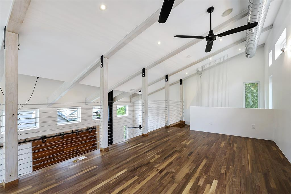 Per the seller, the second floor and loft have solid American Black Walnut floors finished in a water-based polyurethane that is both more health-conscious with less VoCs and that also maintains and protects the walnuts natural colors and tones.