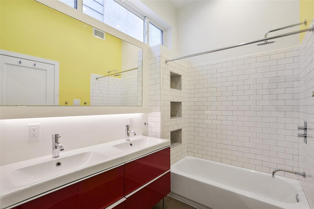 This vibrant guest bathroom is located just off the downstairs secondary bedrooms. You and your guests will appreciate the natural light that enters this space without sacrificing privacy.