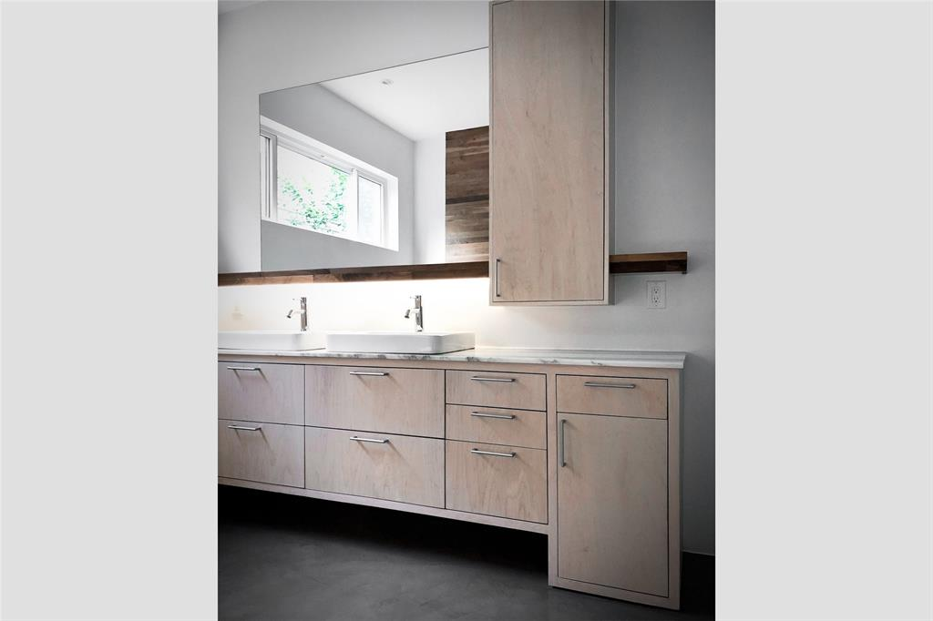 Custom maple cabinetry was built on site for both the kitchen and master bath.