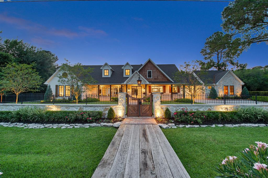 Stunning.  That is the best way to describe this incredible modern, chic, farm house style home. Impeccable venetian plastered walls greet you into the absolutely perfect kitchen finished with rustic wooden beams, high-end luxury appliances, marble counters, and designer light fixtures.  The tasteful use of reclaimed wood and doors along with the custom black framed windows throughout the home will blow you away.  The master retreat is extremely spacious and complete with two closets, two bathrooms, and a large sunroom. The guest house is located just across the porte cochere and has it's own unique finishes to complete the full kitchen, living room, bedroom and bathroom. Out back you will find a relaxing covered patio and pool area directly across the driveway from the showroom style 4 car garage.  This home is something you need to see in person to be able to absorb all it has to offer!  Schedule your private showing to come see it today.