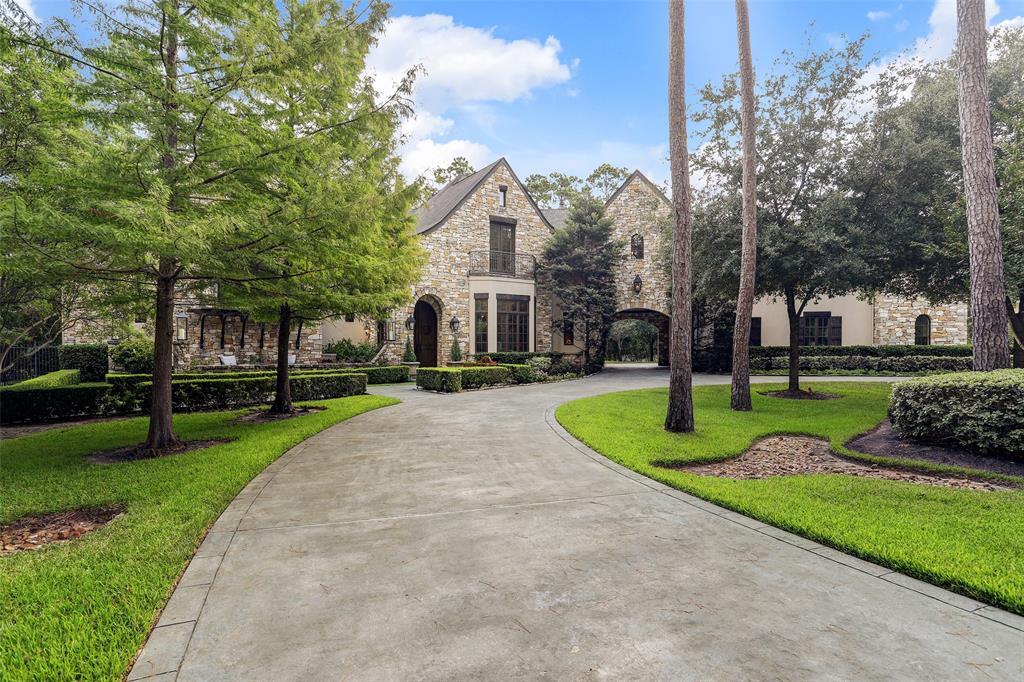 Exquisite custom estate on a 1-acre plus lot within a gated community in The Woodlands. This private French inspired home showcases a circular wooded drive, tranquil courtyard with a fountain, a regal balcony, and lush greenery. Upon entering the home you are introduced to a stunning view of the pool waterfall and soaring ceilings that open up to a multitude of entertainment areas. A 2-level great room attributes an inviting fireplace making this a majestic study/library. The theatre room offers cutting edge technology with a comfortable feel. The kitchen opens up to the family room and comes equipped with a granite island for prep space, ample cabinetry, Wolf and Thermador appliances, spacious butler's pantry, plus a wine fridge. Master retreat features a gym, fireplace and a refreshing Tuscany inspired bathroom with a private veranda. Lastly, an amazing outdoor space complete with 2 entertainment areas and a beautiful waterfall with a dazzling fire display! Impress your buyers today!