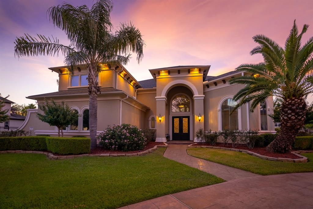Exquisite design and luxury are uniquely embodied in this 6 bedroom 4.5 bath dream home located in the exclusive gated community of Commanders Point. Enter through double forged iron doors into a dramatic entry featuring 2O ft soaring celings. The professionally equipped open gathering kitchen & family room are perfect for hosting large gatherings.  Experience the builder's vision of luxury in the grand sized master suite with tray ceilings, massive windows, and an opulent en-suite bath with soaking tub and separate glass shower.  A secondary bedroom with en-suite bath is located downstairs.  Two dramatic stairways lead to the private bedroom suites, all boasting en-suite baths, generous closets, and scenic views.  The upper level features a large gameroom with artisan wood floors & outdoor terrace. Sprawling entertainment spaces flow outside to the open air terrace featuring a heated pool with cascading spillways, outdoor kitchen, and massive backyard providing stunning waterviews.