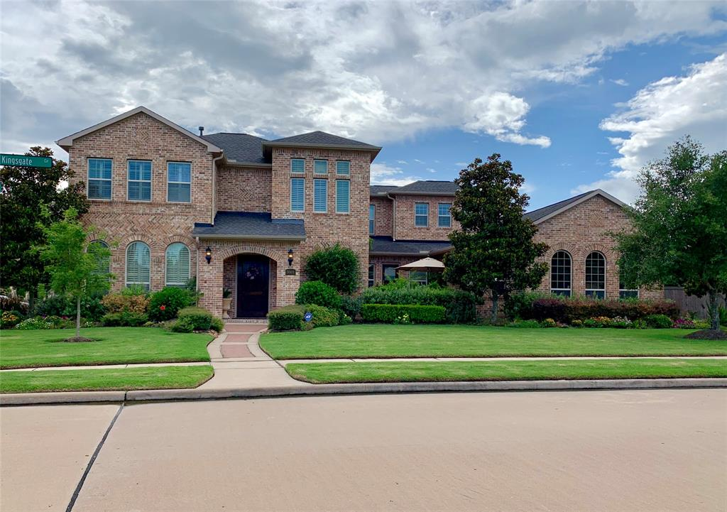 Gorgeous custom Mediterranean home on over-sized lot w/exquisite landscaping. Great floorplan in gated community in a priceless location 1 mi from I-10. Full of beautiful details starting w/wood-tile entryway. limestone fireplace, large windows in den looking out to pool w/3M protective film. Home has 2 full bedrooms down. Master has a sitting area looking out to the jaw-dropping garden. Master bath has separate spa-shower with fireplace, 2 immense closets with custom built-ins. Large kitchen perfect for a home chef. Large island with prep sink and walk-in pantry beside sitting area. Huge breakfast area opening up to patio. Spacious secondary bedrooms w/ large walk-in closets. Media room, gameroom  w/kitchenette. Study niche with built-ins. Stunning back yard with heated pool+spa. Covered patio & pergola perfect for entertaining. Outdoor kitchen with grill and fridge. Outdoor TV with surround sound. Large green space perfect for kids & pets. Organic raised bed  garden. Zoned to KATYISD