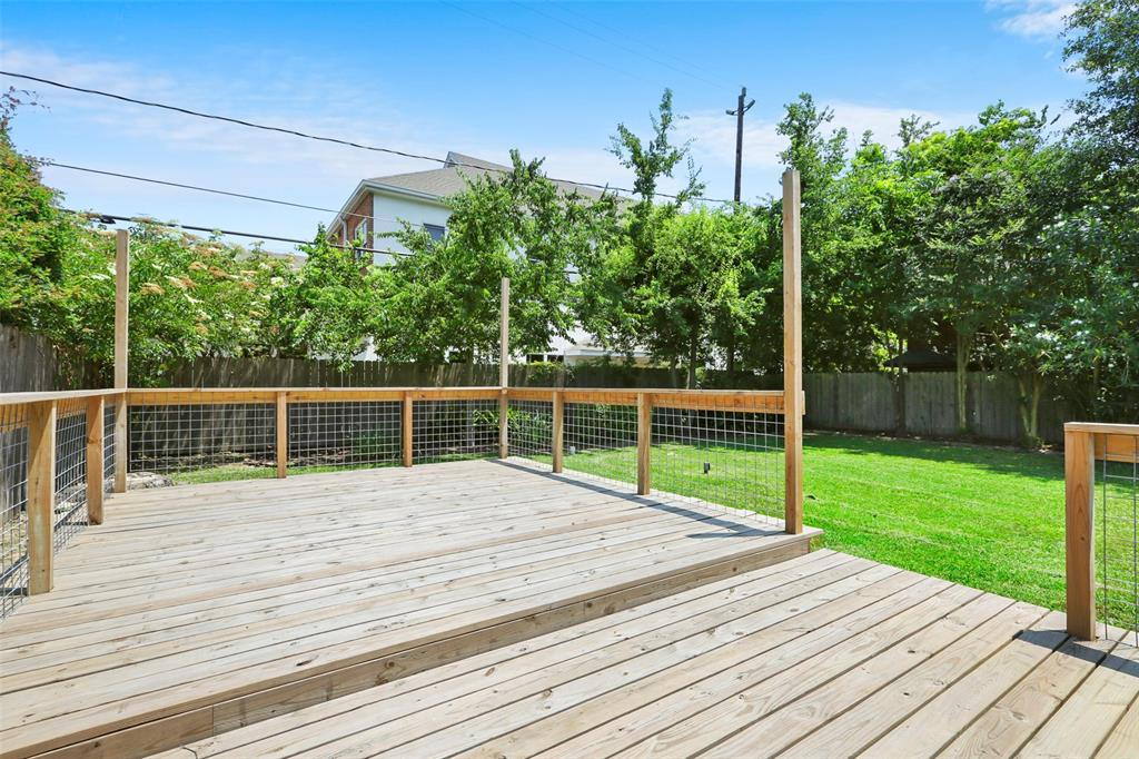 Back yard is fenced. Yard looks awesome. Deck is in excellent condition. Great for hosting right?