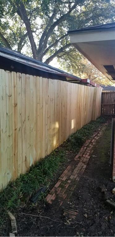 New fencing on the east side of the house.