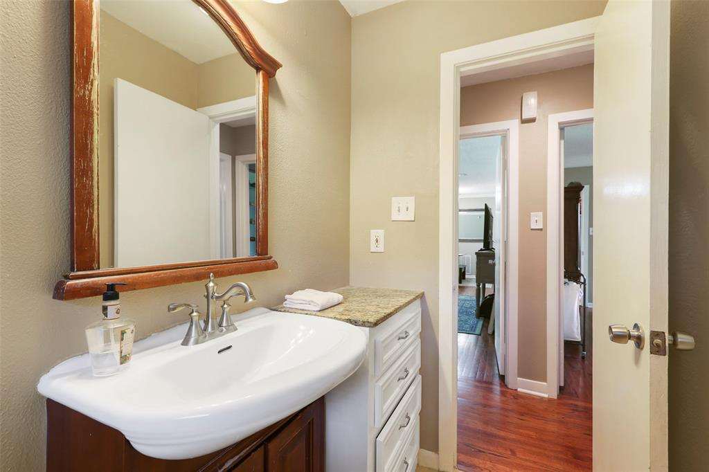 Bath/shower combination, pretty tile accents and attractive sink/vanity area.