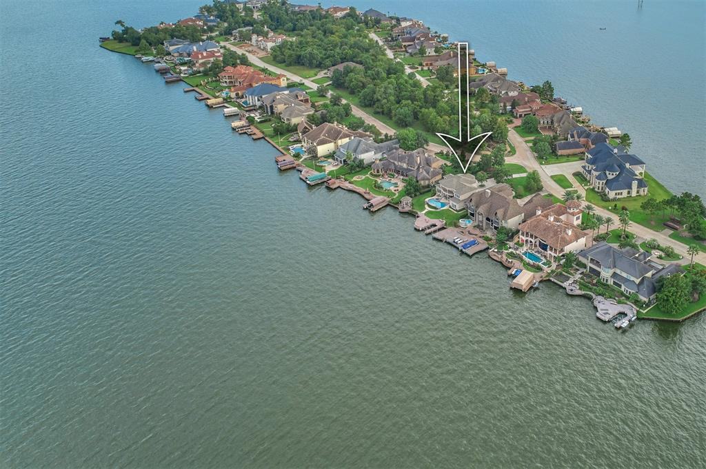 Custom designed & built w/ attention to detail located on the exclusive BENTHAVEN ISLAND! This waterfront estate has expansive waterfront views across Lake Conroe & golf views of Weiskoph #14! It offers an attractive floor plan & quality you won't want to miss. Entertaining backyard w/ large pool & spa, large covered porch & balcony, & plenty of yard space! Deepwater/boat slip/jet ski platform/gazebo & preferred NE exposure w/ afternoon shade! Features include: soaring 2 story ceilings, abundant lake views w/ large sunny windows, open kitchen w/ double ovens, granite, huge island, SubZero side-by-side fridge, prep sink, & wet bar. Sweeping staircase w/ wrought iron balusters & Unbelievable trim work throughout! 2 Masters down w/ primary master suite & secondary on the opposite side of the home. 2 sizeable secondary bedrooms, flex room & Gameroom upstairs! Oversized 3 car garage w/ separate workshop/project area. See feature list for a complete list of upgrades. Masters Golf available.