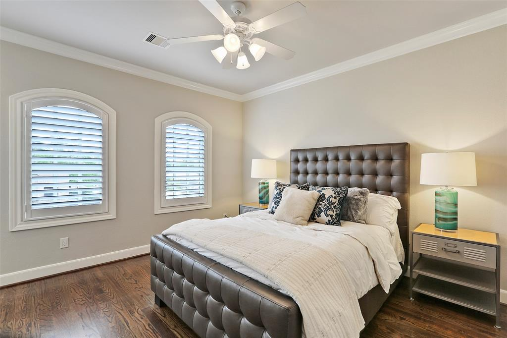 Bedroom # 3 features wood floors, crown molding and plantation shutters.
