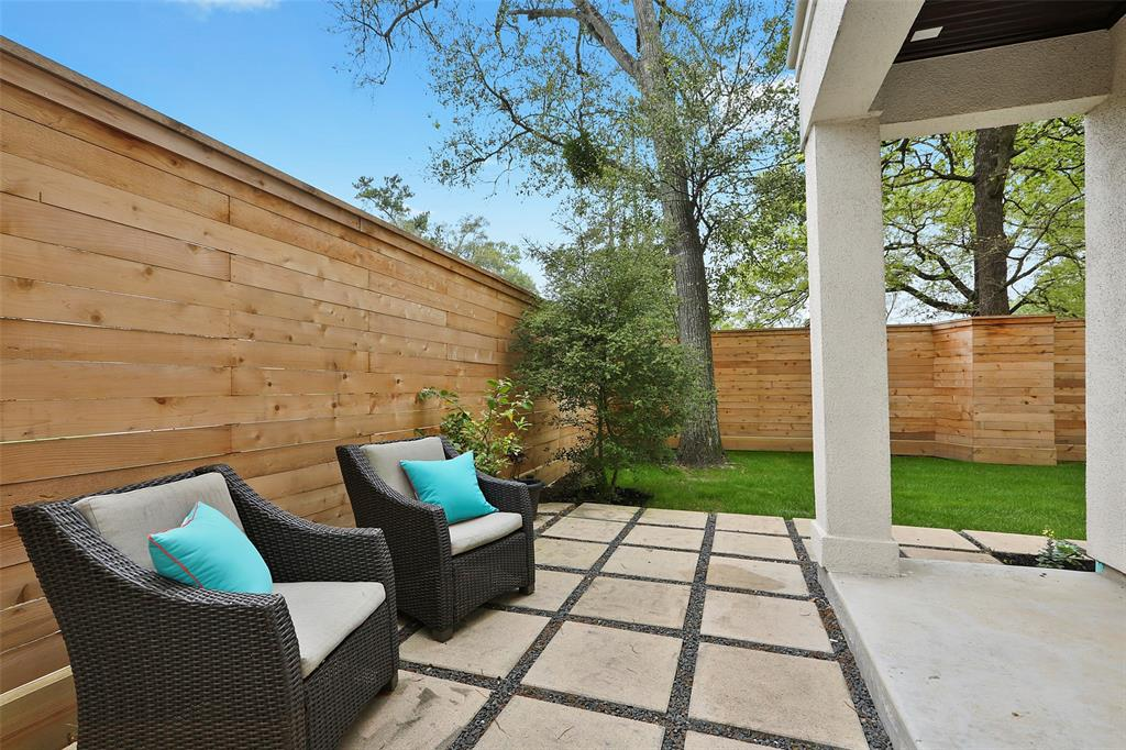 The back yard patio and seating area offers another great option for entertaining or relaxing with your family.