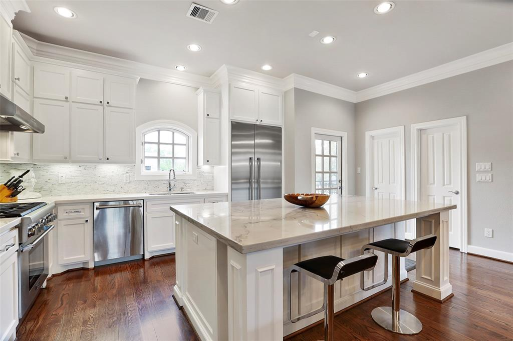 Your family will love gathering around the center island kitchen with quartz counter tops and counter seating.