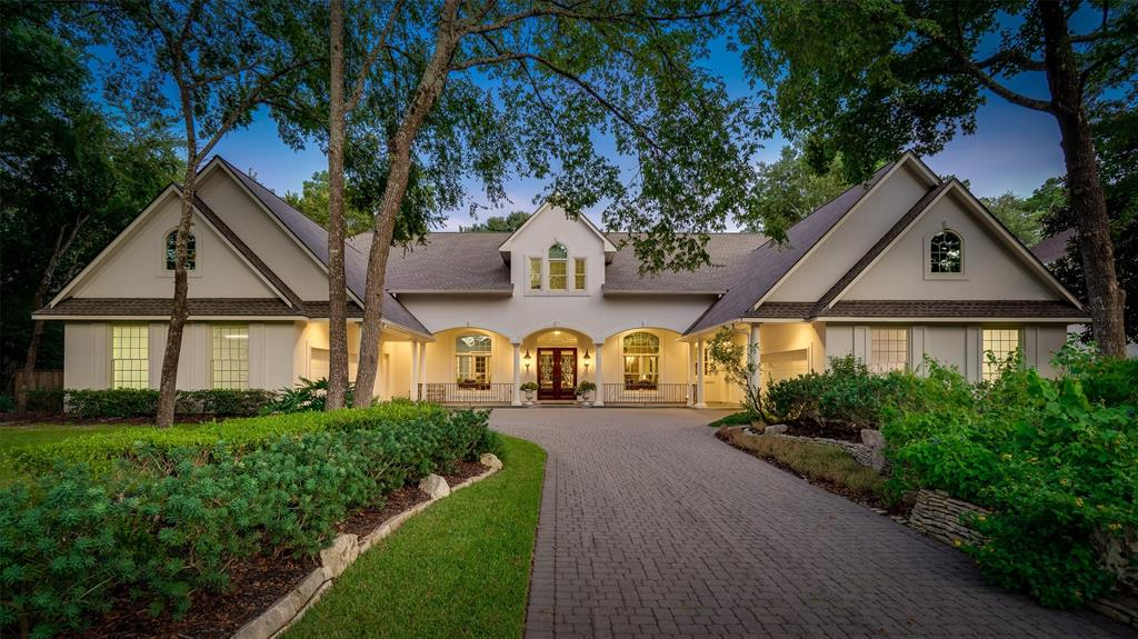 Exceptionally charming curb appeal welcomes all to this John Post custom home backing to the TPC golf course! Showcasing a bright, open floor plan this beauty highlights a well manicured landscape, beautiful gardens, 25+ meter lap pool (newly resurfaced 3/2019) and inviting covered front and back porches. Inside, soaring ceilings, wood floors, spacious formals, master, first floor guest bedroom with private en-suite bath, high-end kitchen and den. Upstairs offers a huge living/game/media area with full bar, over-sized bedrooms w/all new carpet, 2 large Texas Basements and abundant storage, each above garages! Large storage Plenty of parking and dual two car garages. Roof is 2 years young (3/2017)! Location is what it is all about, convenient to all The Woodlands amenities, George Mitchell Pavilion, shopping, dining, quick access to I-45 and the Grand Parkway. NO FLOODING!