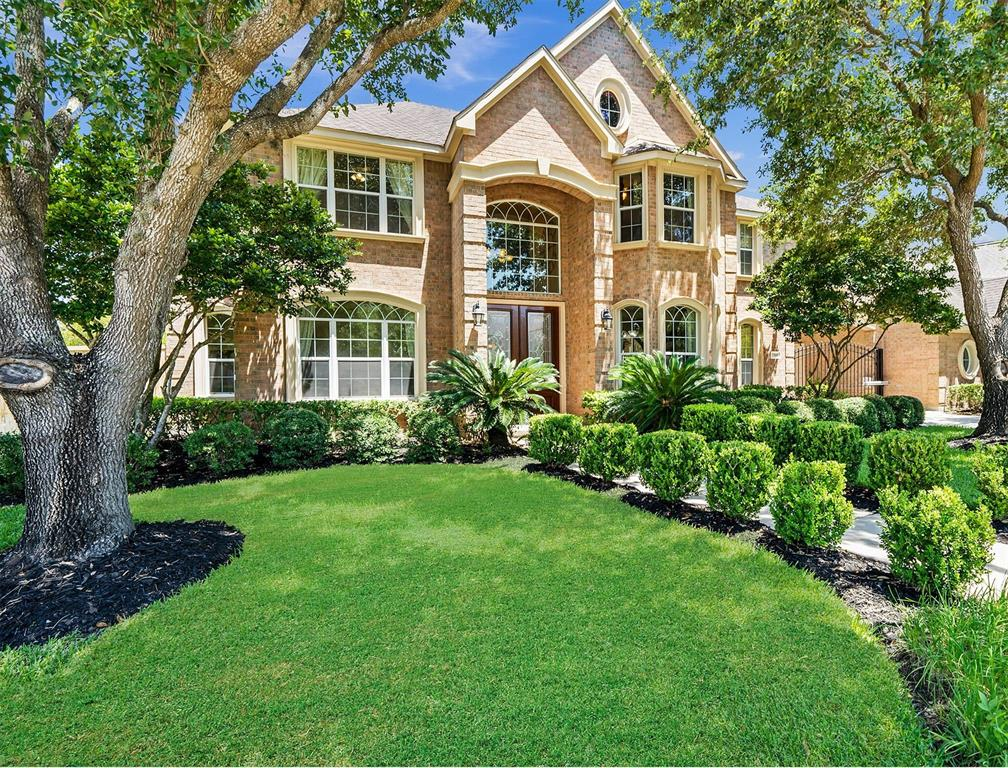 WELCOME TO YOUR CUSTOM DREAM HOME in the well established Greatwood Shores! Home features top of the line ammenities! Walk-in through Dbl Doors to a grand entry w/High Ceilings & beautiful iron staircase! Your dream kitchen features Granite Counters, SS Thermador Appliances,wine fridge,deep sink,Custom Cabinetry,Butlers Pantry,Built ins,Recessed Lighting,Custom Iron Staircase,Built out Storage room w/hardwoods, Tile/Hardwood Flooring, Oversized Unique Gameroom, Oversized Bdrms w/Master Suite w/sitting area and Dbl Shower/Bath area w/walk in closet! Huge backyard w/Pool/Spa/Covered Patio.