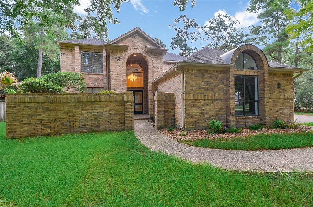 Magnificent two story, 5 bedroom, 4-1/2 bath home with true 3 car garage in the heart of The Woodlands! It's like a new home in an established neighborhood with all the recent updates!  From granite, flooring, paint, fixtures, plus so much more.  Master bedroom found on the first floor. Tile & wood flooring found throughout; no carpet!  Easily use the first floor bedroom as a study, exercise or craft room! Any cook will enjoy the fully updated island kitchen with new appliances and granite counters. Stroll up the stunning staircase to the game room with three additional bedrooms upstairs. Enjoy the view of the oversized backyard & greenbelt from the second story balcony. There's plenty of room to roam & play, even space for that dream pool.  So much to love - discover your next home today!
