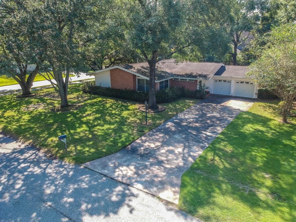 Superb corner lot in Hedwig Village. Lovely oak trees surround this 1 story with lots of potential. Could be renovated or torn down, the property would suite both options. Call today to see this property!!