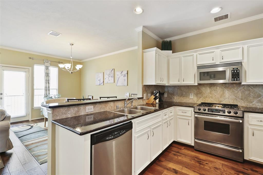 You'll love the counter space and cabinet space this kitchen has to offer.  You'll also love the stainless steel appliances and four burner, gas cook-top.