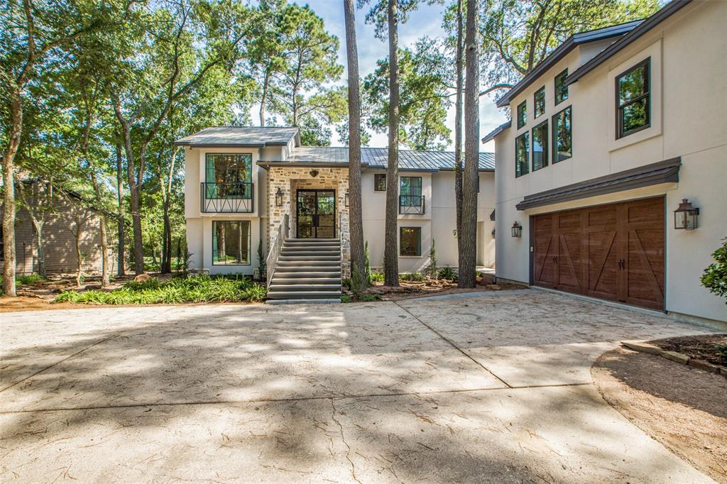 This totally remodeled home sits on the most beautiful golf course lot in The Woodlands! On half an acre at the end of a cul-de-sac with panoramic views of the Oaks course, 17th hole. It was taken down to the studs and rebuilt + added new construction for the garage/apartment. It has all new plumbing, A/C, ductwork, electrical, windows and doors (Anderson E series), spray foam insulation, roof (steel) and TREX deck. Engineered floating stairs lead to steel and glass entry doors. This elegant split level, open concept design blends contemporary and traditional for max light & views. Upstairs you will find the kitchen with quartz countertops, luxury appliances, pot filler. There's also a 2 sided fireplace, floor to ceiling windows and sliders; views from kitchen, living room and master. Downstairs has 3 bdrms, study, laundry and game room. The garage apt has 2 bdrms, full kitchen + living room. In the garage, a/c man cave + shower and 1/2 bath. LOW TAX RATE, NEVER FLOODED, CONROE ISD