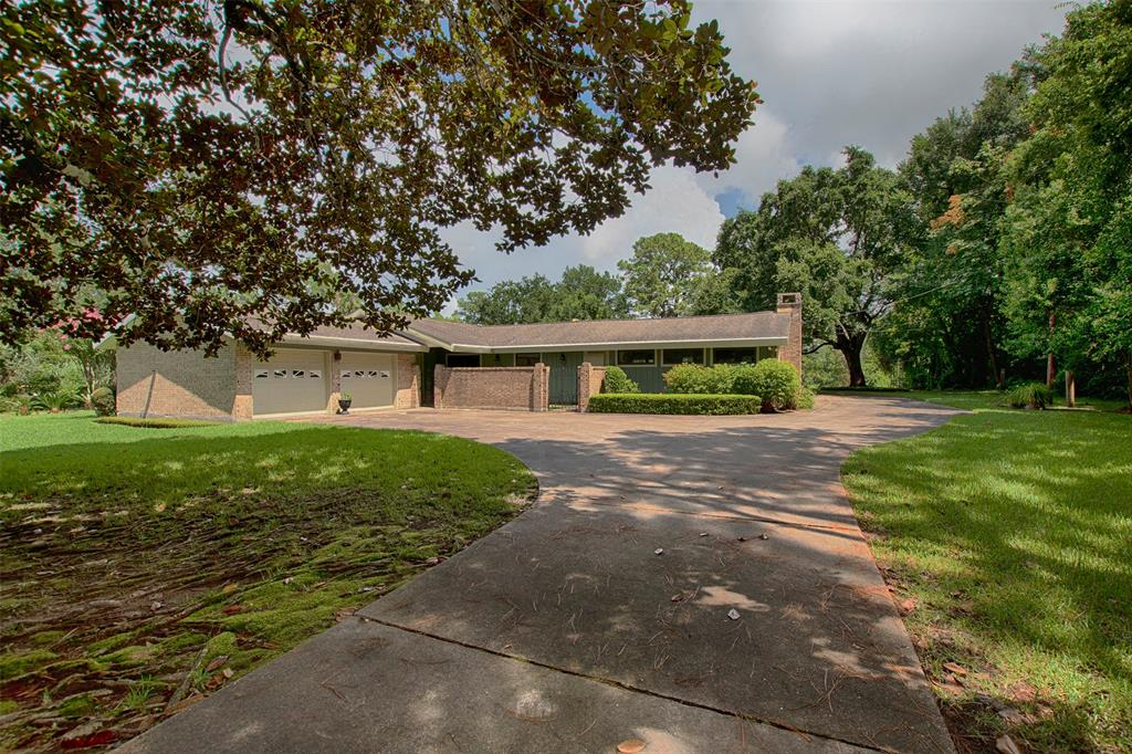 WATERFRONT! NO FLOODING FROM HARVEY! Enjoy the Bayou Life with this spacious 2,204 sf, 3 BR ~ 2.1 Ba ~ 2 Car home with 1,498 sf guest house! This home features a huge family room with high ceilings with beams, a wall of windows with views of the backyard and bayou.  The open floor plan is perfect for entertaining. Master bedroom also features high ceilings and vanity with wood laminate floors. The secondary bedrooms feature a Jack n Jill bath with separate vanities. The backyard has plenty of room to play on 2.25 acres on the bayou with a private boat ramp, a huge greenhouse and a fully equipped 2 bedroom guest house that has a private garage - perfect for your guests, a mother-in-law house or your might even want to consider using it as investment property for weekend rentals. This home is a must see!